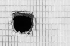 Hole on the old white wall Royalty Free Stock Image