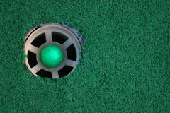 Hole In One. A hole in one, mini-golf style Royalty Free Stock Photo