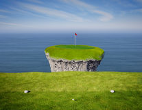 Hole in One. View of an impossible golf link viewed from the tee box Stock Images