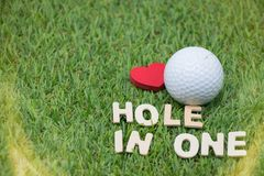 Hole in one golf. Hole in one wording on green course Stock Image