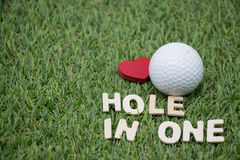 Hole in one golf. Hole in one wording on green course Royalty Free Stock Image