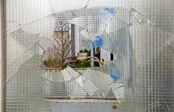 a hole in a pane of wired glass Stock Photography