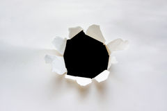 Hole on paper background stock images