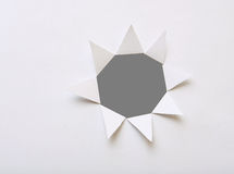 Hole on paper. Hole on white sheet of paper and gray background Royalty Free Stock Photo