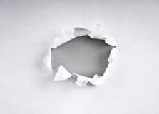 Hole in the paper. With torn sides Royalty Free Stock Photography