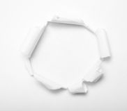 Hole in paper. Hole in white paper with empty inside Royalty Free Stock Photo