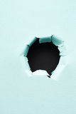 Hole in the paper Royalty Free Stock Photo