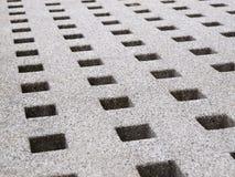 Hole pattern on stone Stock Images