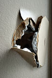Hole in Plaster. A large hole in a plaster wall. This is a picture from a house under renovation Royalty Free Stock Images