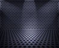 Hole punched metal. Background sheet of metal covered with lines of circular holes Stock Image