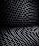 Hole punched metal wallpaper. Background sheet of metal covered with lines of circular holes Royalty Free Stock Images