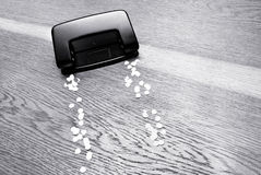 Hole puncher. Hole puncher on a wooden background Royalty Free Stock Photography