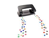 Hole puncher. Hole puncher leaves a trail of colored circles, on white Royalty Free Stock Photos