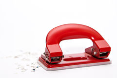 Hole puncher and confetti. Isolated on white royalty free stock image