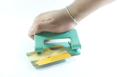 Hole puncher with credit card Stock Photography