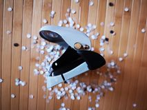 Hole puncher with paper confetti. Detail of hole puncher with paper confetti Stock Images