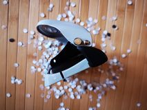 Hole puncher with paper confetti. Detail of hole puncher with paper confetti Royalty Free Stock Photos