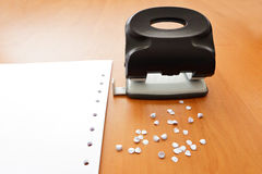 Hole puncher with paper and confetti Royalty Free Stock Photography