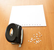 Hole puncher with paper and confetti Royalty Free Stock Images