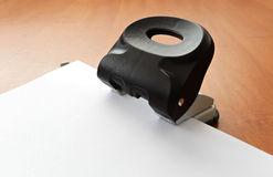 Hole puncher with paper Royalty Free Stock Image