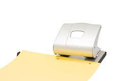 Hole puncher at work isolated Stock Photos