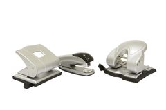 Hole punchers and stapler isolated. Two hole punchers and stapler isolated on white Royalty Free Stock Photos