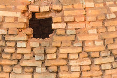 Hole on red brick Royalty Free Stock Image