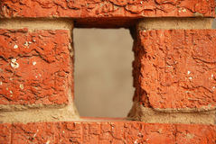 Hole in red brick wall Stock Image
