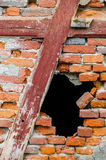 Hole in a red brick wall. Black hole in a red brick wall Stock Photo
