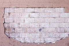 Hole in Render on Wall Showing Bricks Royalty Free Stock Photo