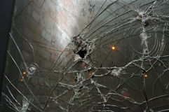 Hole and rifts on  glass Royalty Free Stock Photography