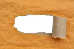 Hole ripped in brown paper Royalty Free Stock Image