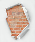 Hole ripped paper. Brick wall background. Clipping path inside Royalty Free Stock Image