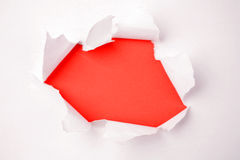 Hole ripped in paper Stock Images