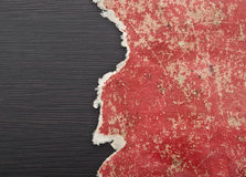 Hole ripped in red paper Stock Photography
