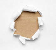 Hole ripped in white paper Royalty Free Stock Photos