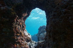 A hole in the rock underwater Pacific ocean Stock Photo