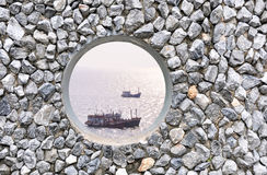 Hole on the rock wall. Hole  on the rock wall  with ocean background Stock Photography