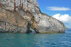Hole in the sea shore cliffs created by the sea Stock Images