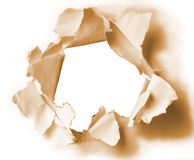 Hole in sepia paper Stock Images