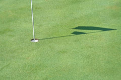 Hole  and shadow of golf flag Stock Photography
