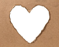Hole in a shape of heart on cardboard Royalty Free Stock Image