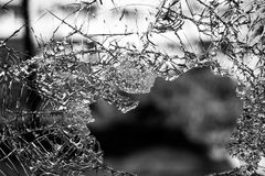 Hole on Shattered Glass Stock Photography