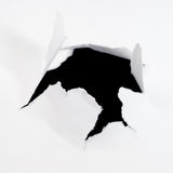 Hole in sheet of paper Stock Image