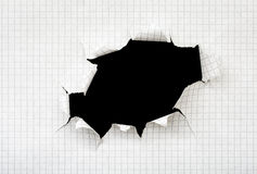 Hole in a sheet of paper Stock Image