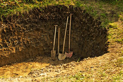 Hole with shovel,spade and hoe Royalty Free Stock Photography