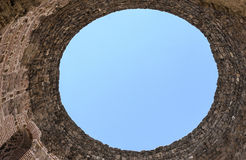 Hole in the sky in a stone pipe. Stock Image