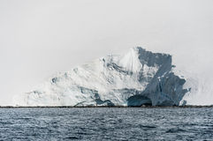 Hole in the snow. This shot was made during expedition to Antarctica in January 2012 Royalty Free Stock Photos