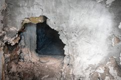Hole in stucco wall Royalty Free Stock Photos