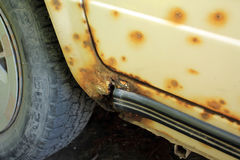 Hole in threshold of old car, damaged by rust and corrosion. Royalty Free Stock Photo